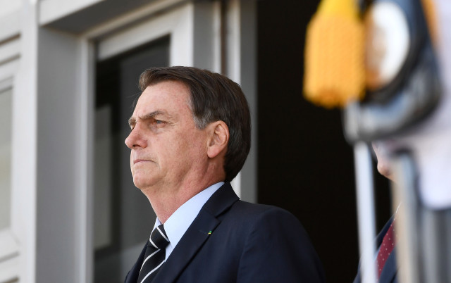 Brazilian President Jair Bolsonaro attends the changing of the guard ceremony at Planalto Palace in Brasilia, on July 31, 2019. - Bolsonaro met with US Secretary of Commerce Wilbur Ross Wednesday in Brasilia. (Photo by EVARISTO SA / AFP)