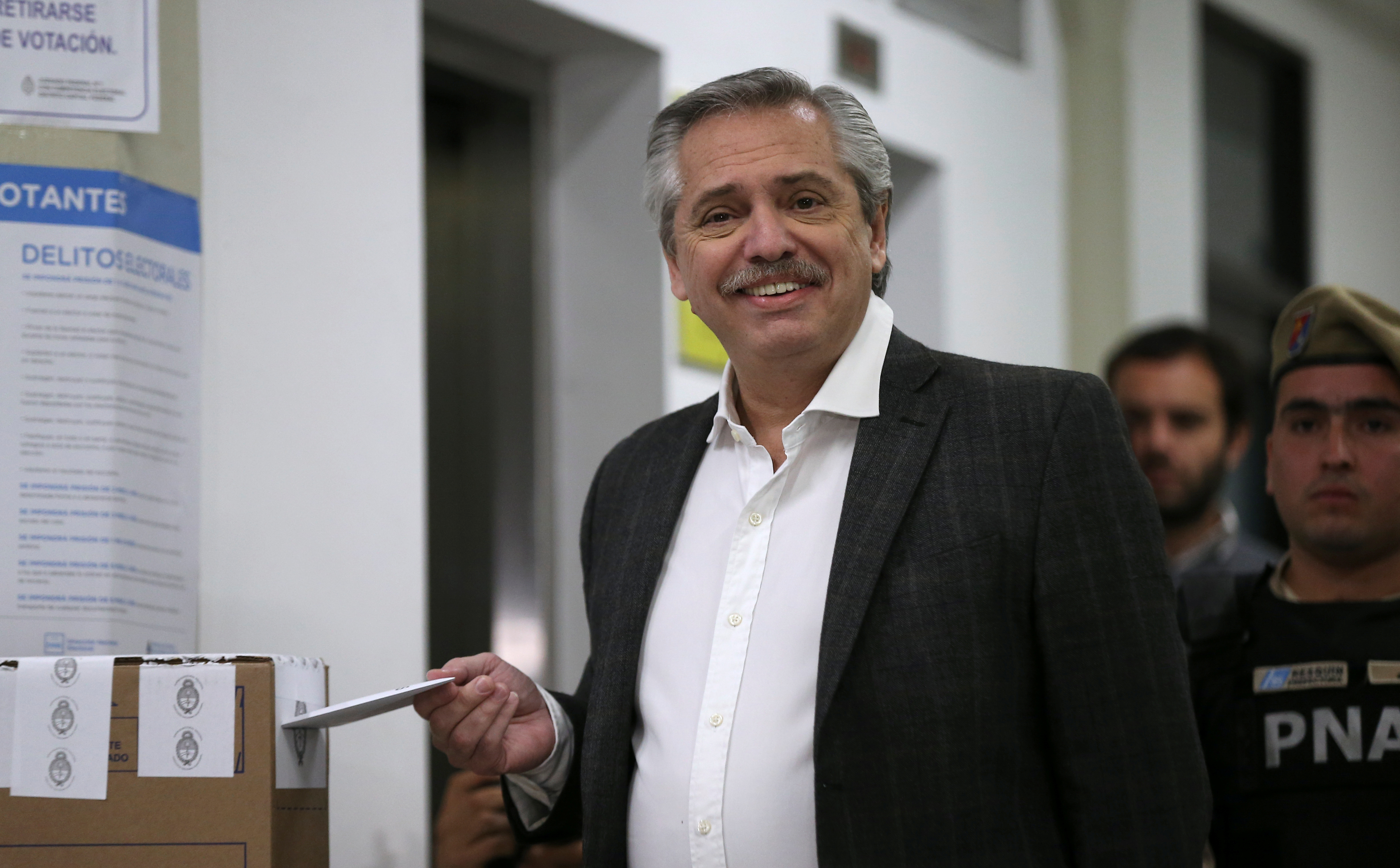 Presidential candidate Alberto Fernandez reacts as he casts a vote at a polling station during the primary elections, in Buenos Aires, Argentina, August 11, 2019.  REUTERS/Agustin Marcarian