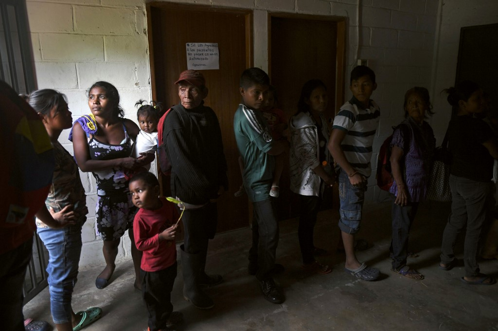 Yukpa natives wait for their turn to have a malaria test done at an improvised laboratory of Los Angeles del Tukuko mission, near Machiques, Zulia state, Venezuela on June 12, 2019. - Malaria, which had been eradicated some years ago among the Yukpa indigenous people, is back in Venezuela due to the crisis. (Photo by YURI CORTEZ / AFP)