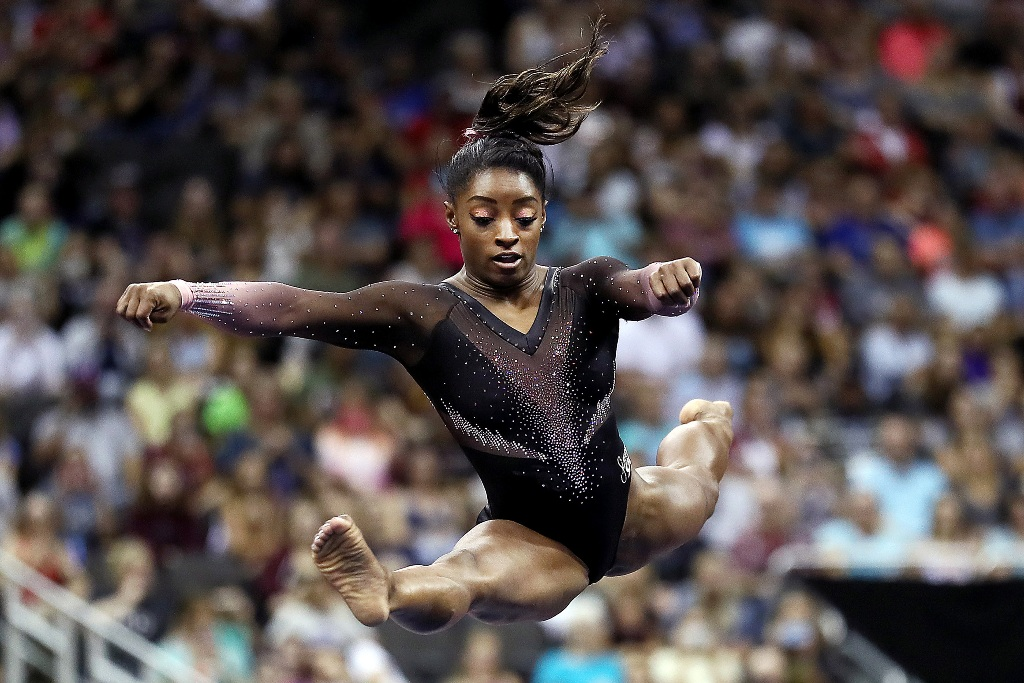 KANSAS CITY, MISSOURI - AUGUST 11:  Simone Biles competes on floor exercise during Women's Senior competition of the 2019 U.S. Gymnastics Championships at the Sprint Center on August 11, 2019 in Kansas City, Missouri. (Photo by Jamie Squire/Getty Images)