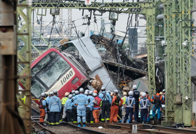 A train is seen derailed after a collision with a truck at a crossing in Yokohama, Kanagawa Prefecture on September 5, 2019. - A train and a truck collided at a crossing near Tokyo, injuring 35 people, with at least one person seriously hurt, authorities said. (Photo by Kazuhiro NOGI / AFP)