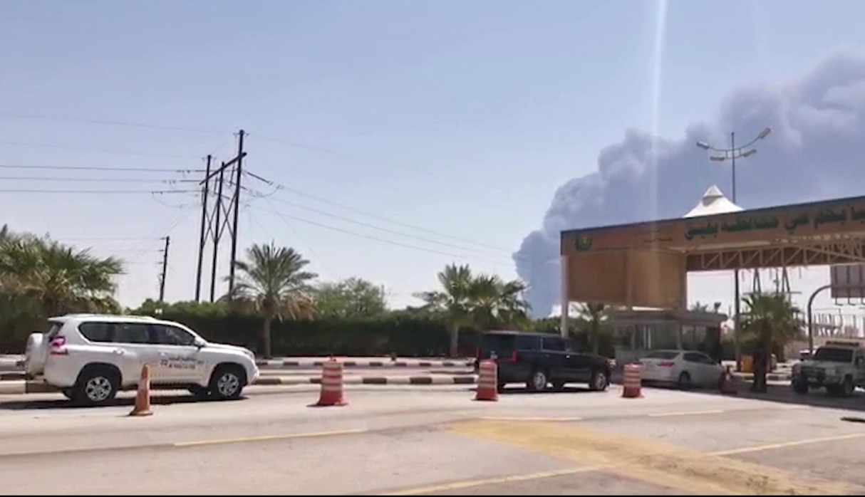 This AFPTV screen grab from a video made on September 14, 2019, shows smoke billowing from an Aramco oil facility in Abqaiq about 60km (37 miles) southwest of Dhahran in Saudi Arabia's eastern province. - Drone attacks sparked fires at two Saudi Aramco oil facilities early today, the interior ministry said, in the latest assault on the state-owned energy giant as it prepares for a much-anticipated stock listing. Yemen's Iran-aligned Huthi rebels claimed the drone attacks, according to the group's Al-Masirah television. (Photo by - / AFP)