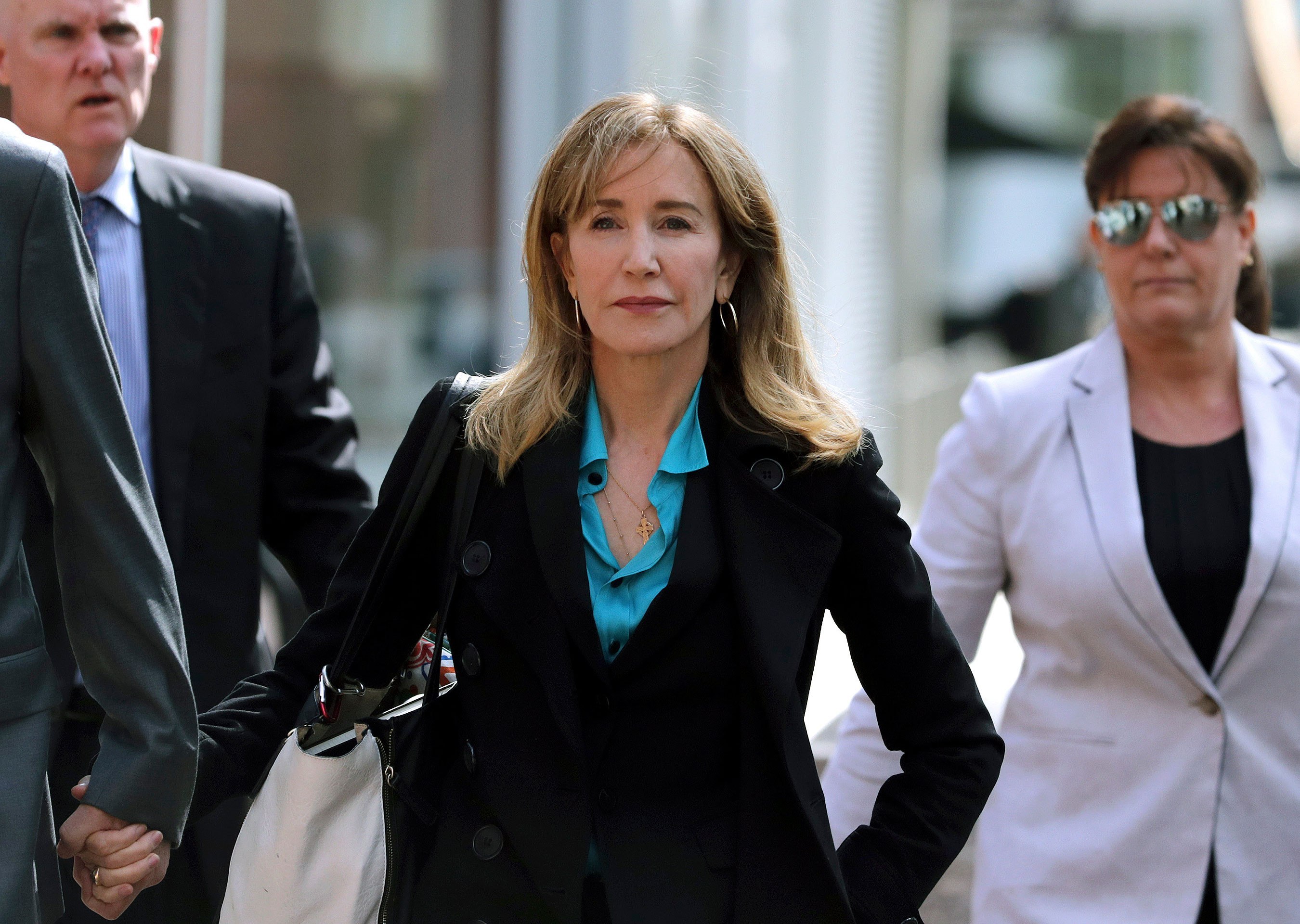 Mandatory Credit: Photo by Charles Krupa/AP/Shutterstock (10185765e) Actress Felicity Huffman arrives at federal court in Boston, to face charges in a nationwide college admissions bribery scandal College Admissions-Bribery, Boston, USA - 03 Apr 2019