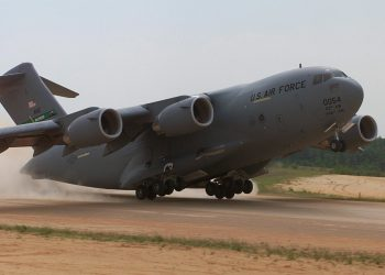 A C-17 Globemaster, 446th Airlift Wing, McChord AFB, Wa. conducts an assult landing at Holland landing zone, Ft. Bragg, N.C.  onTuesday, May 9, 2000. During Rodeo 2000, teams from all over the world will compete in areas including airdrop, aerial refueling, aircraft navigation, special tactics, short field landings, cargo loading, engine running on/offloads, aeromedical evacuations and security forces operations.  From May 6 to 13, over 80 aircraft representing more than 100 teams from 17 countries will bring in about 3,500 competitors, observers, umpires, and support people to Pope AFB, NC.  1st Combat Camera Image by Technical Sergeant James E. Lotz