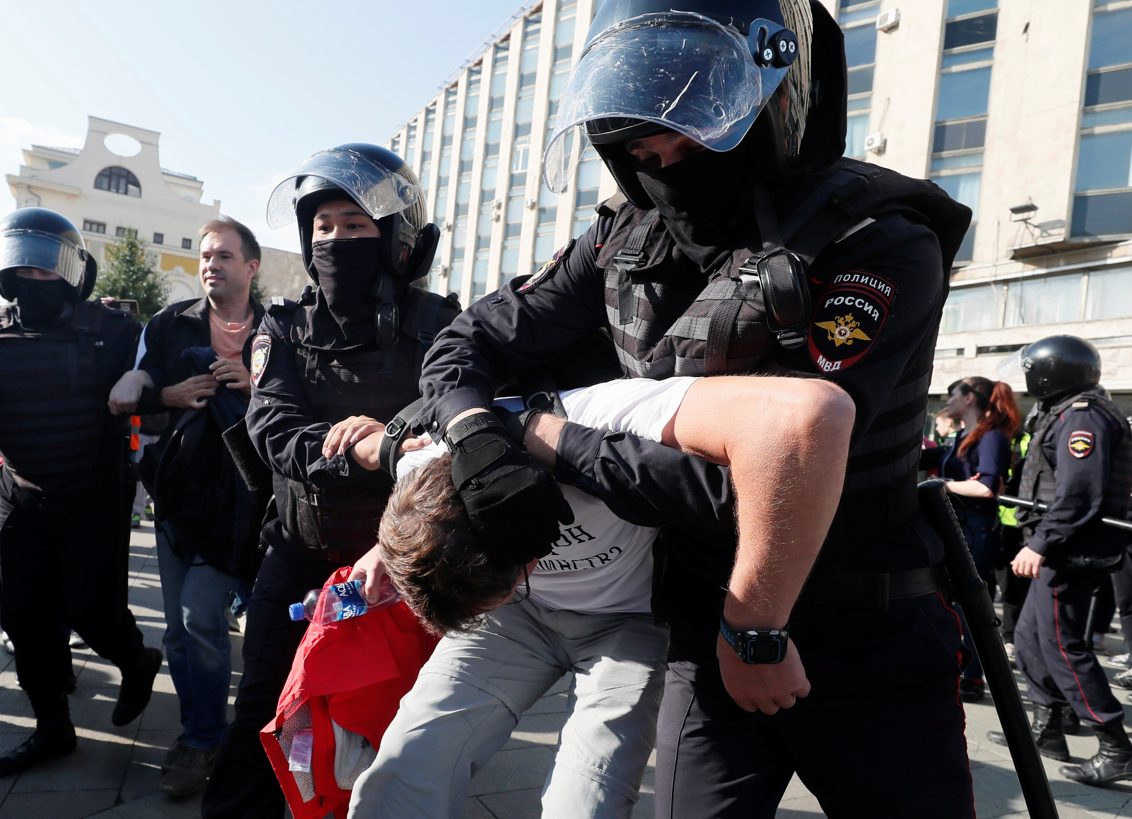 Law enforcement officers detain a participant in a rally calling for opposition candidates to be registered for elections to Moscow City Duma, the capital's regional parliament, in Moscow, Russia August 3, 2019. REUTERS/Shamil Zhumatov