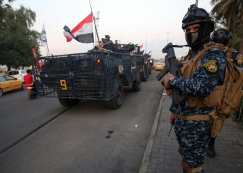 "Iraqi police are seen deployed in Baghdad's predominantly Shiite Sadr City, on October 7, 2019. - Demonstrations across Baghdad and the south have spiralled into violence over the last week, with witnesses reporting security forces using water cannons, tear gas and live rounds and authorities saying ""unidentified snipers"" have shot at protesters and police. On Sunday evening a mass protest in Sadr City in east Baghdad led to clashes that medics and security forces said left 13 people dead. (Photo by AHMAD AL-RUBAYE / AFP)"
