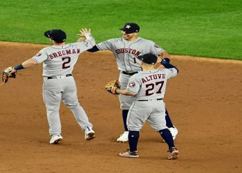 NEW YORK, NEW YORK - OCTOBER 15: Alex Bregman #2, Carlos Correa #1 and Jose Altuve #27 of the Houston Astros celebrate their 4-1 win over the New York Yankees during game three of the American League Championship Series at Yankee Stadium on October 15, 2019 in the Bronx borough of New York City.   Emilee Chinn/Getty Images/AFP