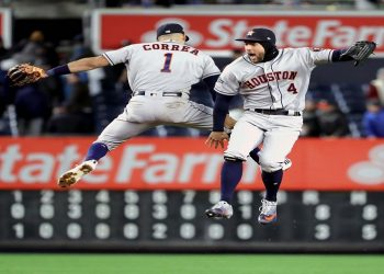 NEW YORK, NEW YORK - OCTOBER 17: Carlos Correa #1 and George Springer #4 of the Houston Astros celebrate their teams 8-3 win over the New York Yankees in game four of the American League Championship Series at Yankee Stadium on October 17, 2019 in New York City.   Elsa/Getty Images/AFP