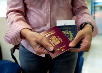 "Mariana Elias, 27, shows her Venezuelan and Spanish passports at the Simon Bolivar International Airport, La Guaira, Venezuela, January 14, 2019. Before moving to Barcelona in January, Elias spent years in Caracas doing two degrees in chemical and production engineering. Her reason for moving to Barcelona was straightforward: ""My job ambitions. As I really prepared myself academically, I wanted to have the opportunity in the long-term to progress and upgrade. I wasn't able to see that in Venezuela right now."" REUTERS/Ana Maria Arevalo Gosen  SEARCH ""AREVALO SPAIN"" FOR THIS STORY. SEARCH ""WIDER IMAGE"" FOR ALL STORIES."