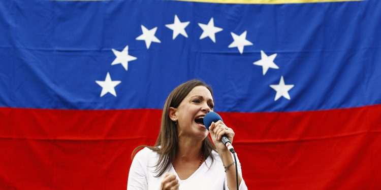 Opposition deputy Maria Corina Machado speaks during a rally against Nicolas Maduro's government in Caracas March 3, 2014. Jailed Venezuelan opposition leader Leopoldo Lopez urged sympathizers on Monday to maintain street protests against President Nicolas Maduro as the country's foreign minister prepared to meet the United Nations Secretary General. REUTERS/Carlos Garcia Rawlins (VENEZUELA - Tags: POLITICS CIVIL UNREST) - RTR3FZXR
