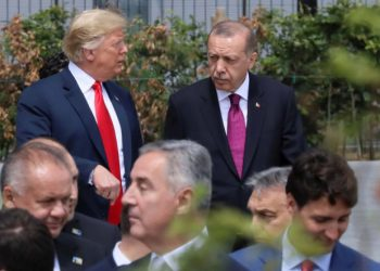 U.S. President Donald Trump, Turkish President Tayyip Erdogan and Canada's Prime Minister Justin Trudeau are seen at the start of the NATO summit in Brussels, Belgium July 11, 2018.   REUTERS/Reinhard Krause