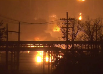Flames rise over a petrochemical plant after an explosion in a still image from video in Port Neches, Texas, U.S. November 27, 2019.  12NewsNow.com via REUTERS. NO ARCHIVES. NO SALES. THIS IMAGE HAS BEEN SUPPLIED BY A THIRD PARTY. MANDATORY CREDIT.