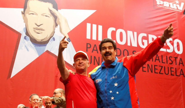 FILE PHOTO: Venezuela's President Nicolas Maduro (R) embraces retired General Hugo Carvajal as they attend the Socialist party congress in Caracas, Venezuela July 27, 2014. Miraflores Palace/Handout via REUTERS/File Photo ATTENTION EDITORS - THIS PICTURE WAS PROVIDED BY A THIRD PARTY.
