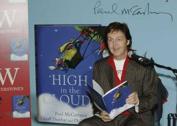 """LONDON - DECEMBER 14:  Sir Paul McCartney reads to children from Princes Plain Primary School as he launches his first children's book """"High In The Clouds"""" at Waterstone's, Piccadilly on December 14, 2005 in London, England.  (Photo by Gareth Cattermole/Getty Images) *** Local Caption *** Paul McCartney"""