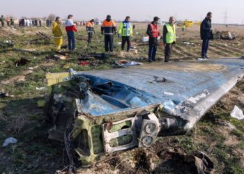 """(FILES) In this file handout photo provided by the Iranian news agency IRNA on January 8, 2020, rescue teams work at the scene of a Ukrainian airliner that crashed shortly after take-off near Imam Khomeini airport in the Iranian capital Tehran. - US officials believe that Iran accidentally shot down the Ukrainian airliner, killing all of the 176 people on board, US media reported on January 9, 2020. Newsweek, CBS and CNN quoted unnamed officials saying they are increasingly confident that Iranian air defense systems accidentally downed the aircraft, based on satellite, radar and electronic data. (Photo by Akbar TAVAKOLI / IRNA / AFP) / RESTRICTED TO EDITORIAL USE - MANDATORY CREDIT """"AFP PHOTO/IRNA/AKBAR TAVAKOLI"""" - NO MARKETING NO ADVERTISING CAMPAIGNS - DISTRIBUTED AS A SERVICE TO CLIENTS ---"""