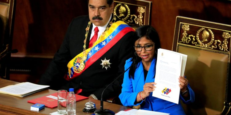 Venezuela's President Nicolas Maduro looks on as National Constituent Assembly President Delcy Rodriguez shows a document during a special session of the National Constituent Assembly to take Maduro's oath as re-elected President at the Palacio Federal Legislativo in Caracas, Venezuela May 24, 2018. REUTERS/Marco Bello