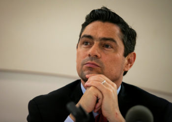 Carlos Vecchio, the envoy to the U.S. for Venezuela's opposition leader Juan Guaido, listens during an announcement that he is naming former Caracas police commissioner Ivan Simonovis as a national security advisor for the embassy, at Bolivarian Hall at the Embassy of Venezuela, in Washington, U.S., July 10, 2019. REUTERS/Al Drago