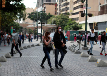 People wear protective masks in response to coronavirus (COVID-19) spread, in Caracas, Venezuela March 13, 2020. REUTERS/Carlos Jasso