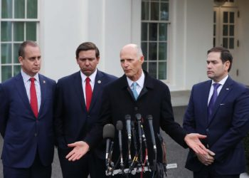 WASHINGTON, DC - JANUARY 22: Sen. Rick Scott (R-FL) speaks to the media while flanked by (L-R) Rep. Mario Diaz-Balart (R-FL), Florida Governor Ron DeSantis and Sen. Marco Rubio (R-FL), after a meeting with President Donald Trump regarding Venezuela on January 22, 2019 in Washington, DC.   Mark Wilson/Getty Images/AFP