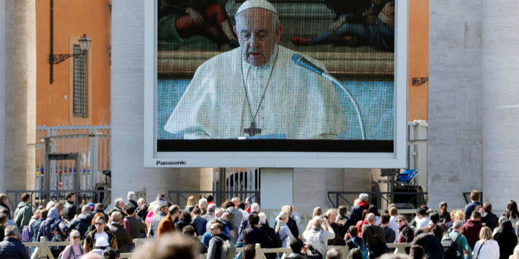 Pope Francis delivers his weekly Angelus prayer via video transmitted on the screen on St. Peter's Square, in Vatican March 8, 2020. REUTERS/Remo Casilli