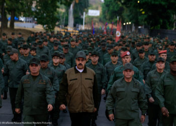 Venezuela's President Nicolas Maduro walks next to Venezuela's Defense Minister Vladimir Padrino Lopez and Remigio Ceballos, Strategic Operational Commander of the Bolivarian National Armed Forces, during a ceremony at a military base in Caracas, Venezuela May 2, 2019. (© Miraflores Palace/Handout/Reuters Pictures)
