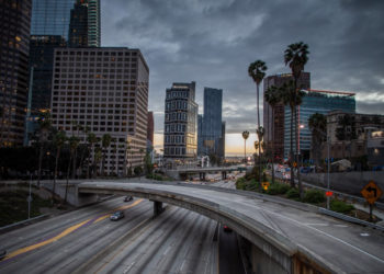 (FILES) In this file photo taken on March 15, 2020, the 110 Freeeway is seen in downtown Los Angeles, California. - Another 6.65 million US workers filed for unemployment benefits last week, the most ever recorded, as the coronavirus forces businesses to shut down nationwide, the Labor Department reported on April 2, 2020. (Photo by Apu GOMES / AFP)