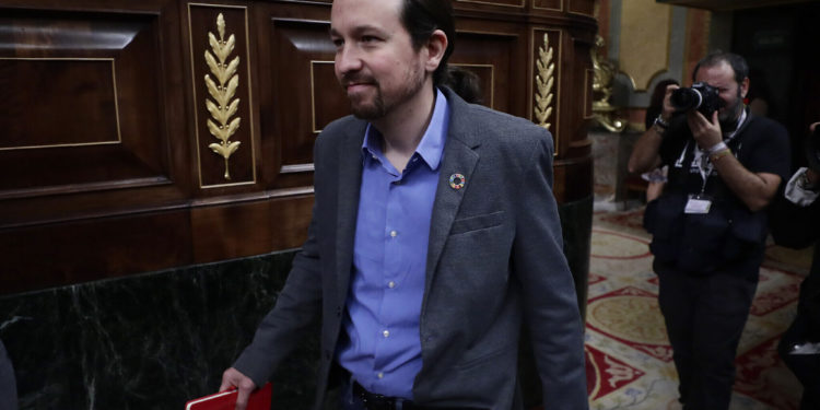 Podemos party leader Pablo Iglesias arrives at the Spanish Parliament in Madrid, Spain, Tuesday, Jan. 7, 2020. Spanish lawmakers are due to vote Tuesday on whether to endorse the formation of a Socialist-led coalition government, ending almost a year of political limbo for the eurozone's fourth-largest economy. (AP Photo/Manu Fernandez)