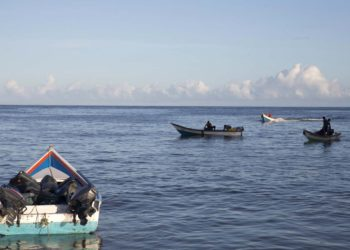A boat loaded with containers is seen in the bay of Rio Caribe, a town near caribbean islands, in the eastern state of Sucre, Venezuela October 30, 2015. Driven by a deepening economic crisis, smuggling across Venezuela's land and maritime borders - as well as illicit domestic trading - has accelerated to unprecedented levels and is transforming society. Although smuggling has a centuries-old history here, the socialist government's generous subsidies and a currency collapse have given it a dramatic new impetus. To match Insight VENEZUELA-SMUGGLING/  Picture taken October 30, 2015.  REUTERS/Carlos Garcia Rawlins