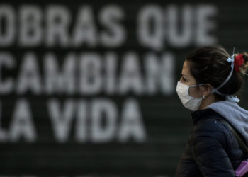 A woman wears a face mask in Buenos Aires, on April 17, 2020 amid the COVID-19 coronavirus pandemic. (Photo by JUAN MABROMATA / AFP)