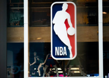 (FILES) In this file photo taken on March 11, 2020 an NBA logo is shown at the 5th Avenue NBA store in New York City.   BasketNBAhealthvirustests - The NBA has advised teams not to arrange coronavirus tests for players and staff not showing symptoms, ESPN reported on May 1, 2020, saying it was inappropriate with only limited public testing available. (Photo by Jeenah Moon / GETTY IMAGES NORTH AMERICA / AFP)