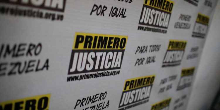 The logo of opposition party Justice First (Primero Justicia) is seen during a news conference in Caracas, Venezuela January 26, 2018. REUTERS/Marco Bello