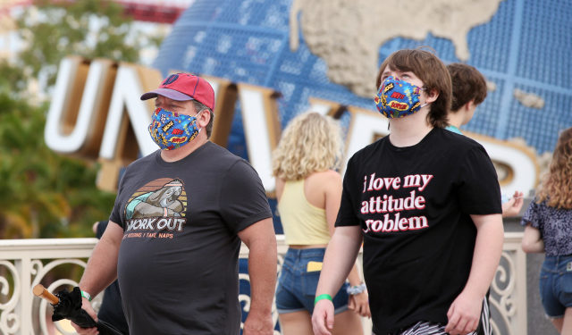 Visitors arrive at Universal Studios theme park on the first day of reopening after the shutdown during the coronavirus pandemic, on June 5, 2020, in Orlando, Florida. (Photo by Gregg Newton / AFP)