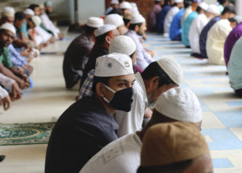 Muslims wear protective masks while offering Friday prayers (Jummah) as a preventive measure against the spread of Coronavirus at National Mosque in Dhaka. (Photo by Sultan Mahmud Mukut / SOPA Images/Sipa USA)(Sipa via AP Images)