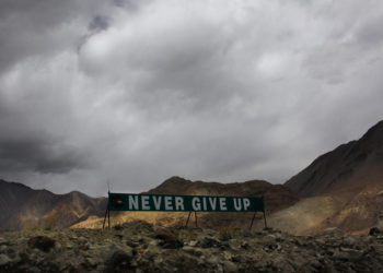 In this Sept. 14, 2017, photo, a banner erected by the Indian army stands near Pangong Tso lake near the India China border in India's Ladakh area. India and China sought Wednesday, June 17, 2020, to de-escalate tensions following a fatal clash along a disputed border high in the Himalayas that left 20 Indian soldiers dead. The skirmish Monday in the desolate alpine area of Ladakh, in Kashmir, followed changes by India to the political status of Kashmir amid a geopolitical tug-of-war with the United States in the region. (AP Photo/Manish Swarup)