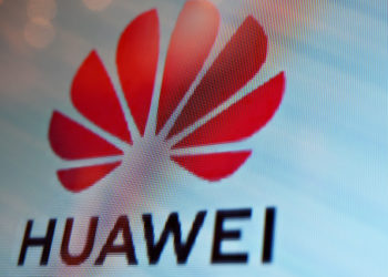 A Huawei logo is seen on a screen during the Mobile World Congress (MWC 2019) introducing next-generation technology at the Shanghai New International Expo Centre (SNIEC) in Shanghai on June 26, 2019. (Photo by Hector RETAMAL / AFP)