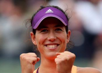 PARIS, FRANCE - MAY 28:  Garbine Muguruza of Spain celebrates her victory in her women's singles match against Serena Williams of the United States on day four of the French Open at Roland Garros on May 28, 2014 in Paris, France.  (Photo by Matthew Stockman/Getty Images)