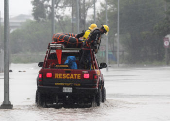 Recue workers are seen on a vehicle crossing a flooded street during Storm Hanna in Apodaca on the outskirts of Monterrey, Mexico July 26, 2020. REUTERS/Daniel Becerril