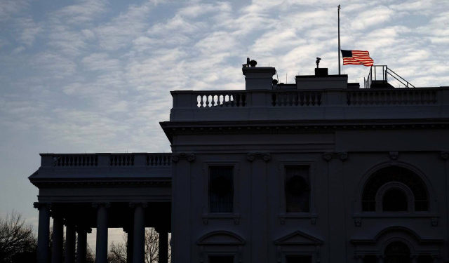 The U.S. flag flies at half staff over the White House in remembrance of former president George H.W. Bush on Christmas morning in Washington, U.S., December 25, 2018. REUTERS/James Lawler Duggan