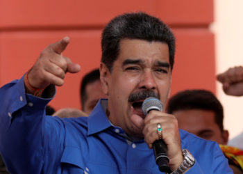 Venezuela's President Nicolas Maduro gestures as he speaks during a rally commemorating the Youth Day, in Caracas, Venezuela February 12, 2020. REUTERS/Fausto Torrealba NO RESALES, NO ARCHIVES