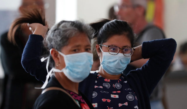 Travelers wear masks at the El Dorado airport in Bogota, Colombia, 17 March 2020. Colombian authorities confirmed eight new cases of coronavirus on Tuesday, bringing the number to 65 across the country, which restricted flights, closed land and sea borders to deal with the pandemic. EFE/ Mauricio Duenas Castaneda
