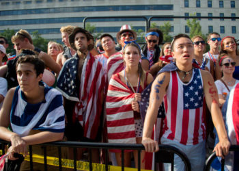 Fans react to the USA's loss to Belgium in the 2014 FIFA World Cup on Freedom Plaza in Washington, DC, July 1, 2014. Kevin De Bruyne and Romelu Lukaku's extra time goals fired Belgium past the United States with a thrilling 2-1 win and into the World Cup quarter-finals.       AFP PHOTO / Jim WATSON