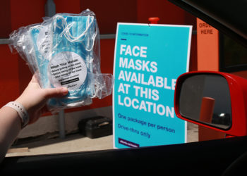 Masks are handed out at an A&W drive-through in Calgary on Wednesday, June 10, 2020.  Gavin Young/Postmedia