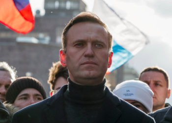 FILE PHOTO: Russian opposition politician Alexei Navalny takes part in a rally to mark the 5th anniversary of opposition politician Boris Nemtsov's murder and to protest against proposed amendments to the country's constitution, in Moscow, Russia February 29, 2020. REUTERS/Shamil Zhumatov -/File Photo