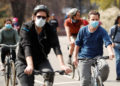 Cyclists wearing masks ride through Prospect Park during the ongoing outbreak of the coronavirus disease (COVID-19) in the Brooklyn borough of New York, U.S., April 19, 2020. REUTERS/Lucas Jackson