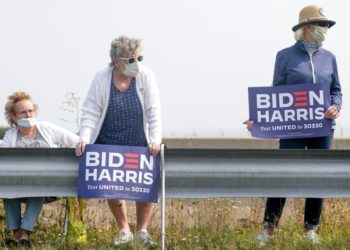 """Vicki Smith, middle, and Karen DeMerit, right, wait for Democratic presidential candidate Joe Biden's arrival on Monday, Sept. 21, 2020, at Green Bay Austin Straubel International Airport in Ashwaubenon, Wis. """"We are really excited to have president elect Joe Biden coming to Wisconsin,"""" DeMerit said. """"We are here to bring America back to civility and we feel that Biden is the person to bring the country that is so divided, together.""""  Ebony Cox/USA TODAY NETWORK-WisconsinGpgbiden11664"""