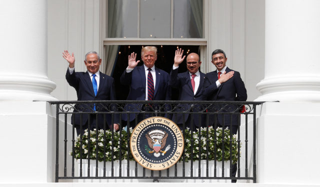 Israel's Prime Minister Benjamin Netanyahu, U.S. President Donald Trump, Bahrain?s Foreign Minister Abdullatif Al Zayani and United Arab Emirates (UAE) Foreign Minister Abdullah bin Zayed wave from the White House balcony after a signing ceremony for the Abraham Accords, normalizing relations between Israel and some of its Middle East neighbors, in a strategic realignment of Middle Eastern countries against Iran, on the South Lawn of the White House in Washington, U.S., September 15, 2020. REUTERS/Tom Brenner