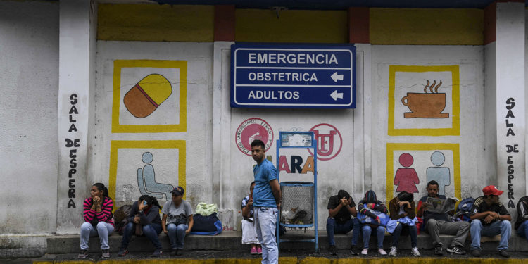 Relatives of patients that are been treated at the University Hospital wait in front of the building in Barquisimeto, Venezuela on April 24, 2019. - Venezuela is facing the worst crisis in its modern history with inflation expecting to soar a mind-boggling 10 million percent this year, contributing to a shortage of basic goods that has caused more than 2.7 million people to flee since 2015, according to the United Nations. (Photo by YURI CORTEZ / AFP)        (Photo credit should read YURI CORTEZ/AFP via Getty Images)
