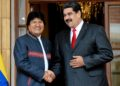 Venezuelan President Nicolas Maduro (R) shakes hands with his Bolivian counterpart Evo Morales during the Bolivarian Alliance for the Peoples of Our America (ALBA) Summit at the Miraflores presidential palace in Caracas on March 5, 2018. (Photo by Federico PARRA / AFP)