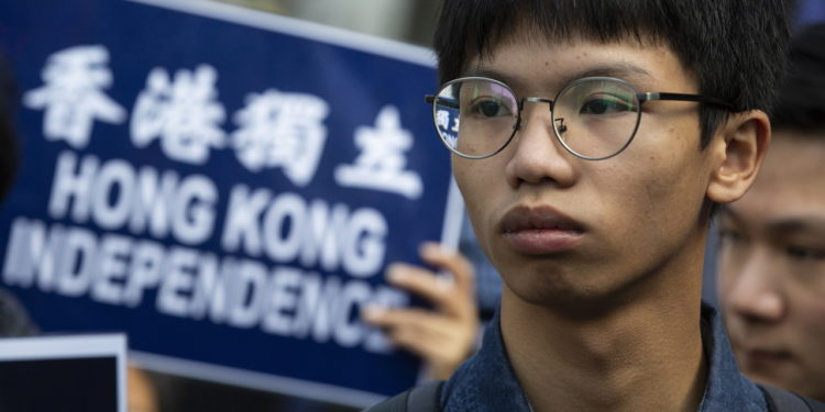 epa08782290 (FILE) - Tony Chung Hon-lam, leader of pro-Hong Kong independence group 'Student Localism' marches through the streets of Hong Kong during the annual New Year's Day protest, Hong Kong, China, 01 January 2019 (reissued 29 October 2020). According to media reports, under the national security law on 29 October, police charged Tony Chung with secession, money laundering and conspiracy to publish seditious material. Chung was arrested on 27 October by plain-clothed police officers near the US consulate in Hong Kong where he was allegedly seeking asylum.  EPA-EFE/ALEX HOFFORD