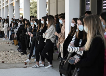 Students and teachers gather at the Aragon secondary school in Muret on November 02, 2020, in homage to slain history teacher Samuel Paty, who was beheaded by an attacker for showing pupils cartoons of the Prophet Mohammed in his civics class, on October 19, 2020, in Conflans-Sainte-Honorine, northwest of Paris. - Paty, 47, was attacked on October 16 on his way home from the junior high school where he taught by 18-year-old Chechen man Abdullakh Anzorov, who was shot dead by police. (Photo by LIONEL BONAVENTURE / AFP)
